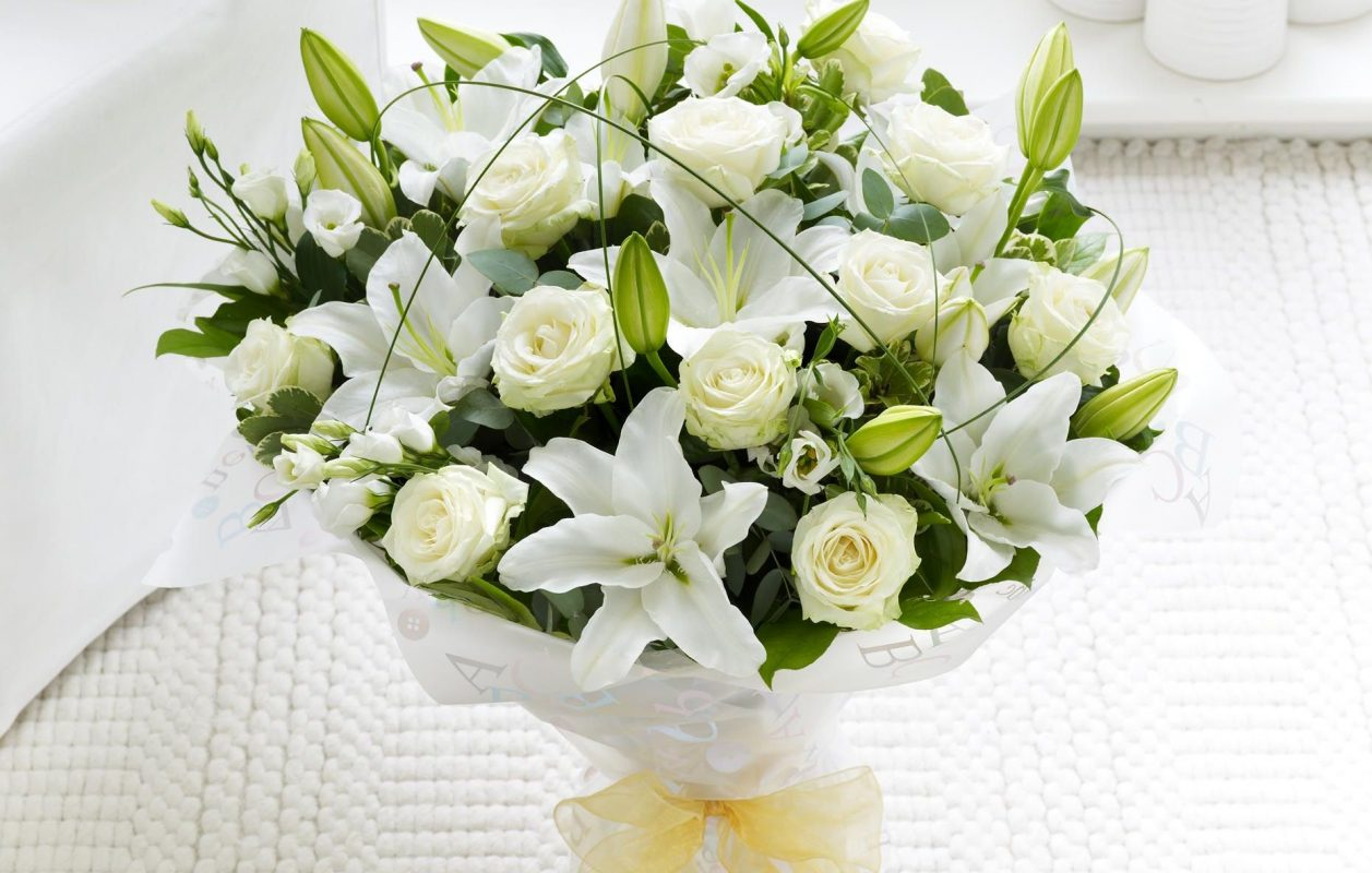 Commemorate the new journey of your loved ones soul with beautiful funeral sympathy flowers izmirmasajfo